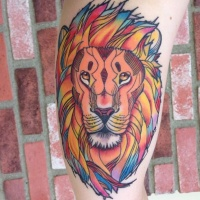 Coloured lion head tattoo by Jamie Lee Parker