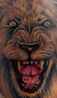 Cool roaring lion tattoo
