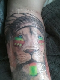 Indian tribe lion tattoo on arm