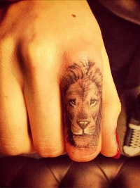 Lion tattoo on finger
