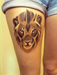 Original lion tattoo on girl hip