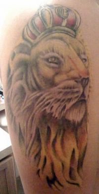 Lion in crown tattoo in colour